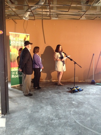 Katie Malarkey, Vice President of the Abundance Board of Directors, speaks at the press conference at 571 South Ave.