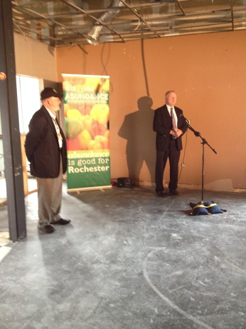 Matt McCarthy, representing the Mayor of Rochester, speaks at the press conference at 571 South Ave.